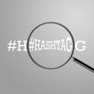 Word hashtag with a magnifying glass